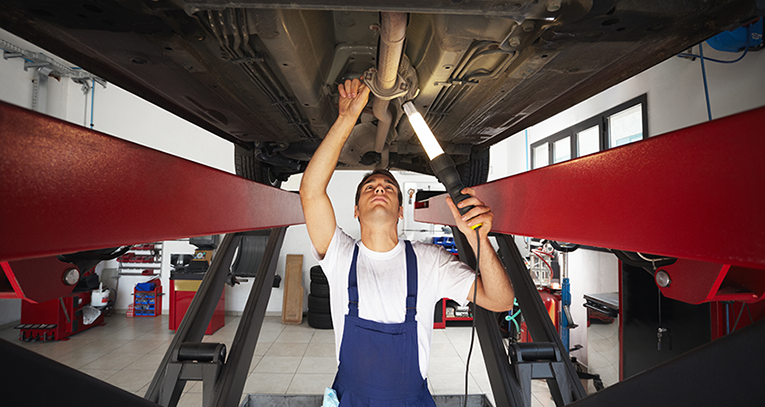 Technician undertaking Car Servicing - Car Servicing Wirral