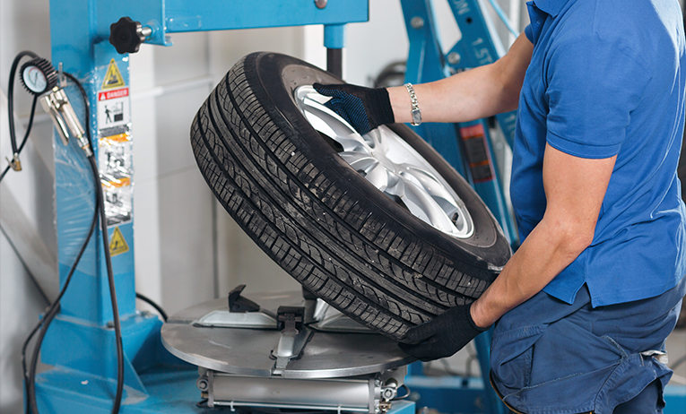 Technician performing Tyre Fitting after a customer has used Online Tyre Ordering - Tyres Wirral